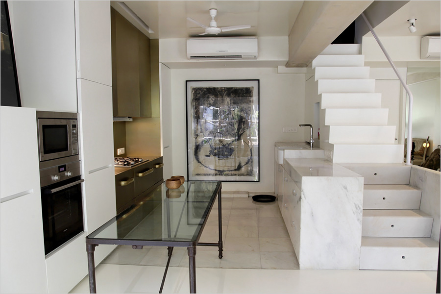 Kitchen and dining area of the house of architect Ashiesh Shah in Mumbai, India on Dec 17, 2010. Shah designed the interior. Photo by Kuni Takahashi NYTCREDIT: Kuni Takahashi for The New York Times