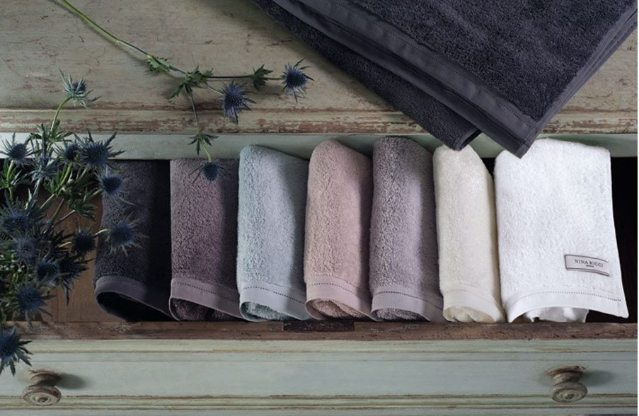 nina ricci home linen bath towels hand towels neatly folded stack