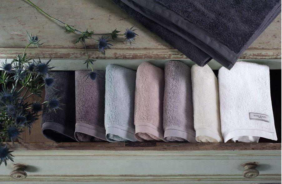 nina ricci home linen bath towels hand towels neatly folded stack