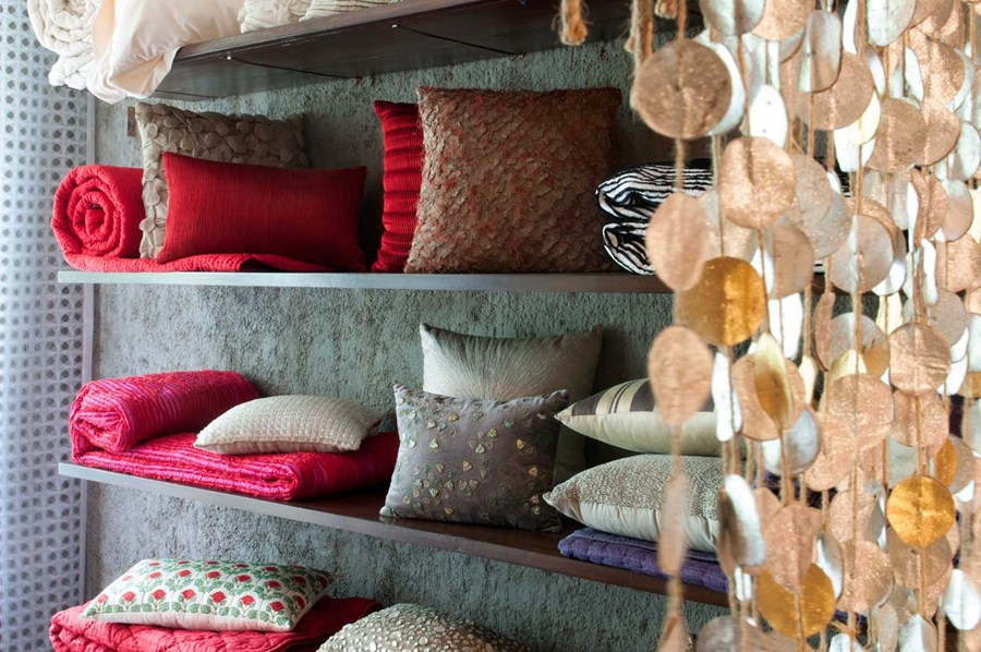 Cushions and quilt on display in shades of india store